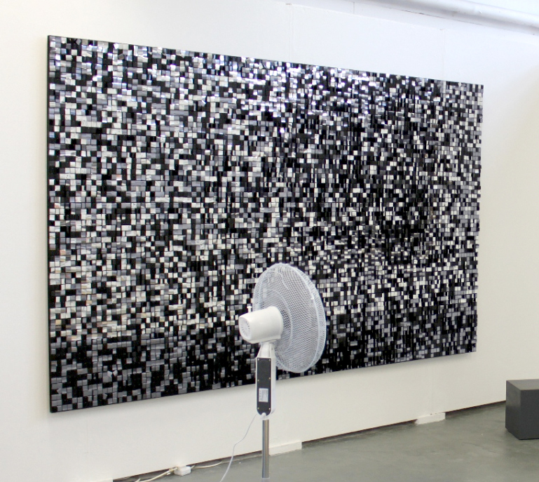 The Big Bang. 175cm x 300cm. Sequins, pins and spray paint on cork and MDF. Office fan. 2011.